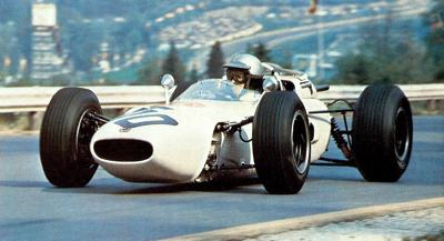 Richie Ginther behind the wheel of his 1.5 liter Honda V12 during the 1965 Belgian Grand Prix at Spa