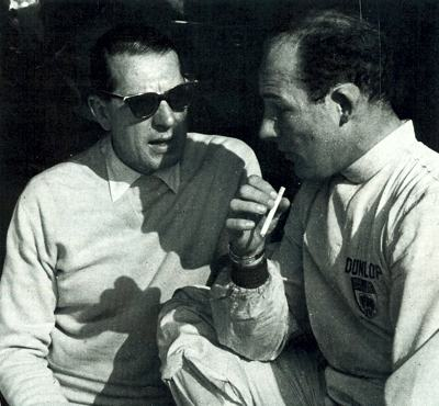 Rob Walker talks with his most successful driver, Stirling Moss