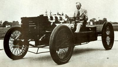 Henry Ford poses with the legendary 999 racer